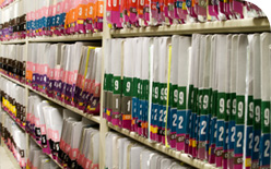 documents stored in folders in an archive facility